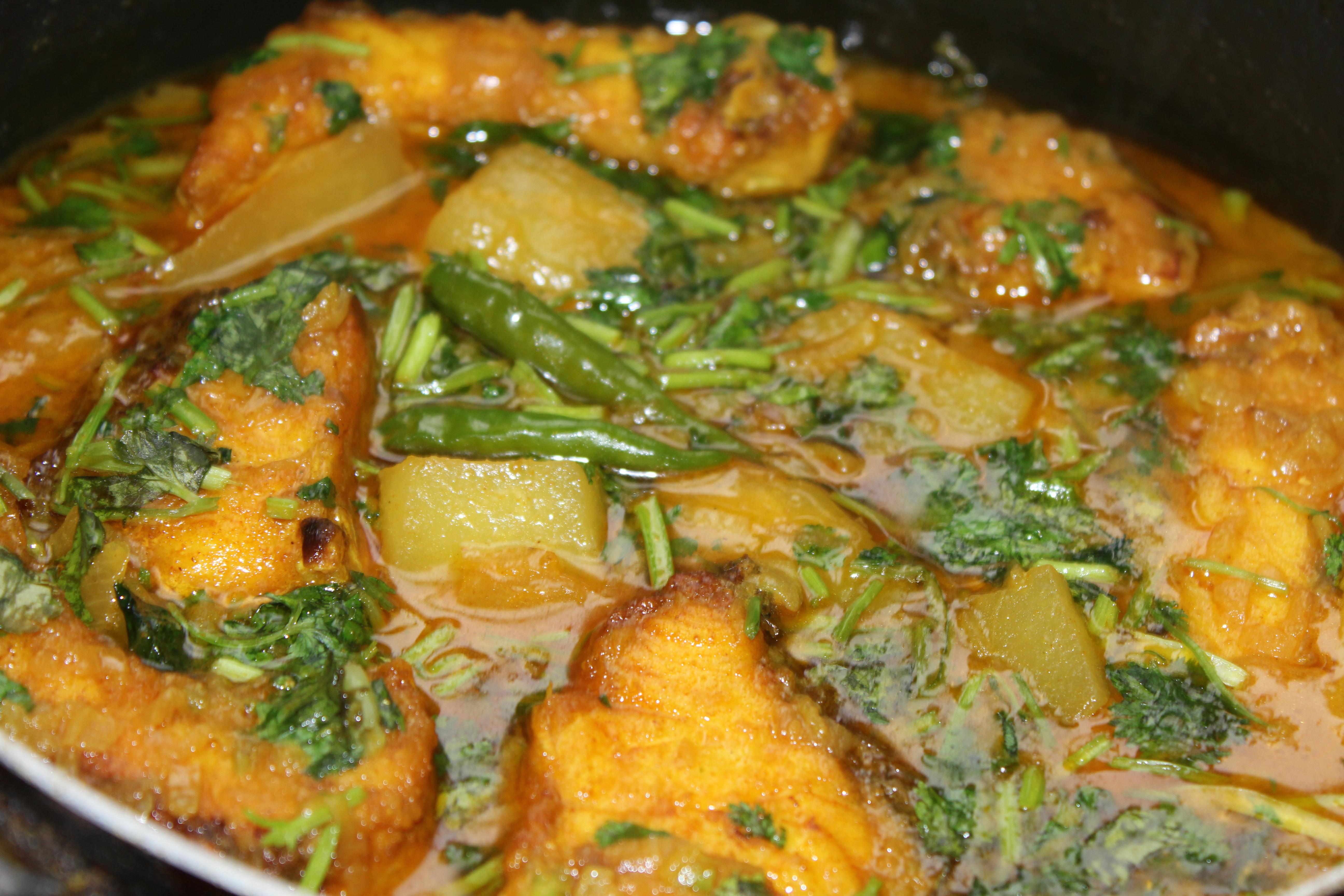 Rohu Fish With Green Papaya Pepe Diye Rui Macher Jhol on Cut Paste Goat